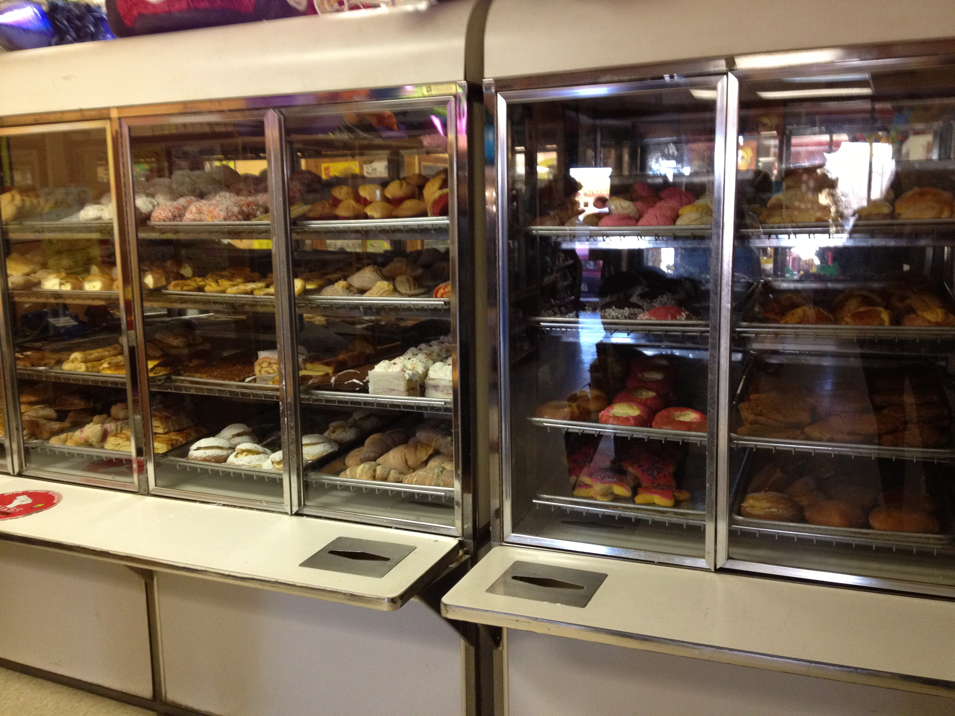 Racks of delicious baked goods at Panaderia